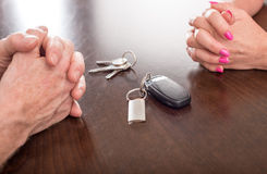 Concept of separation of a couple. With house and car keys Stock Image