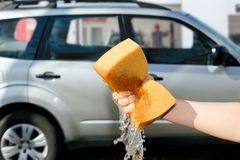 The concept of service auto washing. Royalty Free Stock Photography