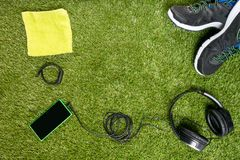 Concept of a set for sport on a background of a green lawn. Concept of set for sport on a background of a green lawn stock image