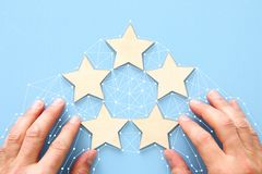 Concept of setting a five star goal. increase rating or ranking, evaluation and classification idea. Concept of setting a five star goal. increase rating or stock images