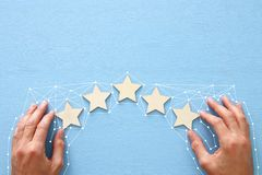 Concept of setting a five star goal. increase rating or ranking, evaluation and classification idea. Concept of setting a five star goal. increase rating or royalty free stock image