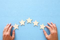 Concept of setting a five star goal. increase rating or ranking, evaluation and classification idea. Concept of setting a five star goal. increase rating or royalty free stock photo