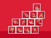 Concept of several hands gesturing inside shelves. Gesturing Stock Photo