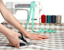 Concept of sewing. Cutting fabric closeup. Dressma Royalty Free Stock Photography