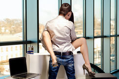 The concept of sexual relations at work Royalty Free Stock Images