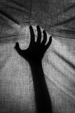 The concept of the shadow of hand behind cloth Stock Photography