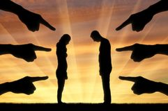 Concept of shame and humiliation. Silhouette, humiliated the man and woman hands pointing a finger at them. The concept of shame and humiliation Royalty Free Stock Images