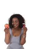 Concept shoot about health care of a woman choosing between an apple and a pill bottle Royalty Free Stock Image