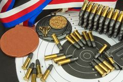 Concept of shooting competitions. Sport shooting. Biathlon background diploma. Tools and targets on wooden background. Caliber ,22 Stock Images
