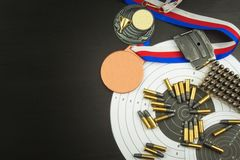Concept of shooting competitions. Sport shooting. Biathlon background diploma. Tools and targets on wooden background. Stock Photos