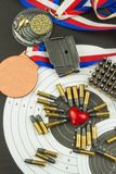Concept of shooting competitions. Sport shooting. Biathlon background diploma. Tools and targets on wooden background. Royalty Free Stock Photos