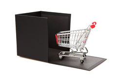 Concept shopping Cart and black gift box Stock Photos
