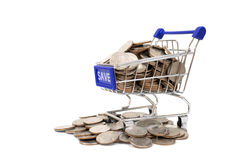 Concept with shopping cart with full of coin. Royalty Free Stock Image