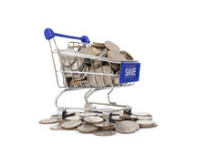Concept with shopping cart with full of coin. Royalty Free Stock Photos