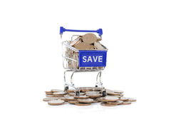 Concept with shopping cart with full of coin. Stock Images