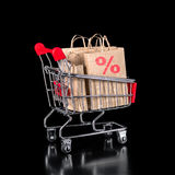Concept of shopping trolley with paper bags is isolated on black Stock Photo