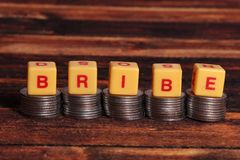 Bribe. Concept shot of bribe on wooden background royalty free stock image