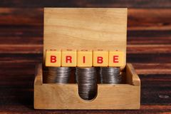 Bribe. Concept shot of bribe on wooden background stock photos