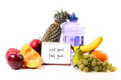 Eat good feel good. Concept shot giving message to eat fresh fruits and to drink lots of water to feel good Royalty Free Stock Images