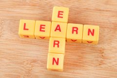 Learn and earn. Concept shot giving message to learn and earn royalty free stock photo