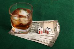 Betting. Concept shot showing whiskey glass with betting money royalty free stock images