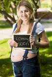 Concept shot of smiling pregnant woman expecting baby Royalty Free Stock Photos