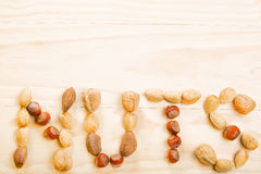 Concept sign from variety of nuts on wooden Royalty Free Stock Image