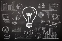 Concept - sketch with schemes and graphs on chalkboard royalty free stock image