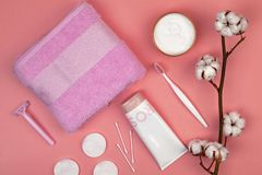 The concept of skin care. Cotton pads for removal makeup, cotton branch, cotton pads, ear sticks, pink towel. Flat lay stock photography