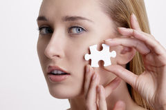 Concept skin health young model with puzzle on here face Royalty Free Stock Photography