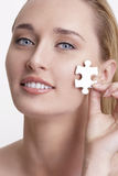 Concept skin health young model with puzzle on here face Stock Photography
