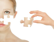 Concept skincare with puzzles. Skin of beauty young woman before and after the procedure isolated on a white background Royalty Free Stock Photo