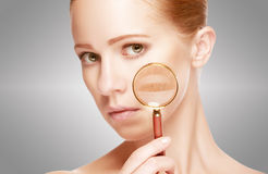 Concept skincare. Skin of woman with magnifier before and after the procedure. Concept skincare. Skin of beauty young woman with magnifier before and after the stock photos