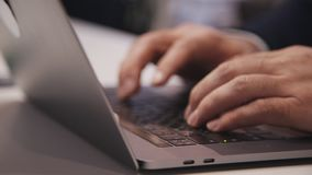Man using laptop pc, sending mail and working in office. Concept of small business. Hands of successful and confident specialists lying on keyboard. Man using stock footage