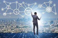 The concept of smart city with businessman pressing buttons stock photography