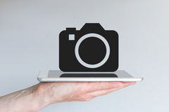 Concept smartphone of tablet als vervanging voor digitale camera/DSLR Stock Foto's