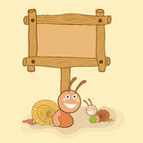Concept of snails with blank wooden board. Stock Photography