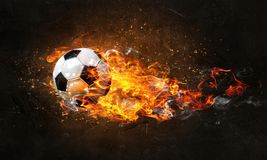 Soccer Ball on Fire. Concept of soccer game with ball in fire flames. Mixed media royalty free stock photos