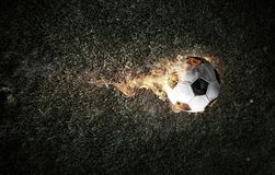 Soccer Ball on Fire. Concept of soccer game with ball in fire flames. Mixed media stock images
