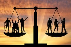 Concept of social b legal equality of persons with disabilities in society. Invalids equal in rights in the balance with healthy people. The concept of social b royalty free stock image
