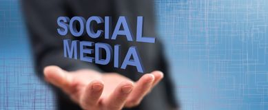 Concept of social media. Social media concept above the hand of a man in background stock photos