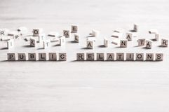 Society and public relations. Concept of social media collected of wooden elements with the letters Stock Photo