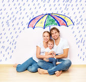 Concept: Social Protection Of Family. Family Took Refuge From Miseries And Rain Under Umbrella Stock Photos