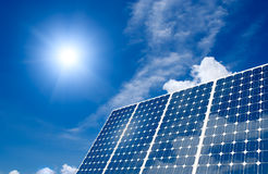 Concept of Solar panel and sun. Concept of Solar panels harness the sun energy Royalty Free Stock Photo
