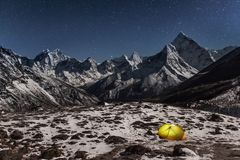 Concept of solitude and freedom in the wild. Night winter camping in the mountains. Grand photo royalty free stock photo