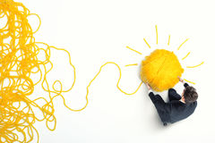 Concept of solution and innovation with wool ball. Concept of solution and innovation with tangle of wool yarn Royalty Free Stock Image
