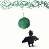Concept of solution and innovation with wool ball. Concept of solution and innovation with tangle of wool yarn Stock Photo