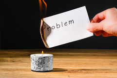 Concept solution probem by burning text on paper Royalty Free Stock Photography