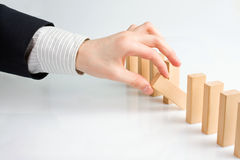 Concept for solution to a problem by stopping the domino effect Stock Image