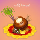 Concept of South Indian festival Happy Pongal celebrations. Traditional mud pot with rice, sugarcane, fruits and illuminated lit lamp on flowers decorated Stock Photo